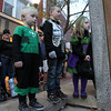 From left, Jameson Ryan, 3, JJ Stien, 7, and Kaleigh Ryan, 6, watch a small flash mob dancing near Rockafellas on Saturday afternoon.  David Le/Staff Photo