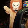 A lion standing in the back of the Salem Lions Club truck waves to the crowd on Thursday evening. David Le/Staff Photo