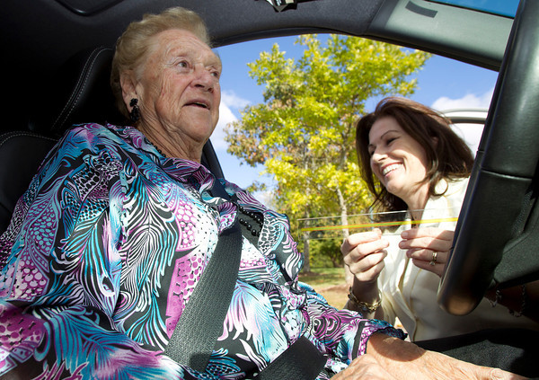 Cathy Andre, right, Volunteer Coordinator at the Danvers Senior Center, measures the distance between the steering wheel and chest of Danvers resident Gloria Lipinski, left, during a 'CarFit' program. David Le/Staff Photo