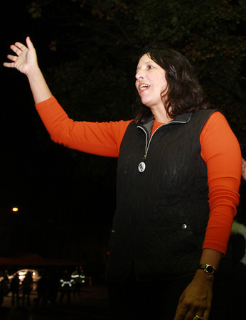 Mayor Kim Driscoll waves to young students and performers alike as they pass by a platform near Salem Common at the end of the annual Halloween Parade on Thursday evening. David Le/Staff Photo