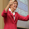 US Senate candidate Elizabeth Warren gives two empatic thumbs up while campaigning at Brooksby Village on Monday afternoon. David Le/Staff Photo