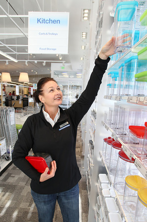Claire Byers, the North Shore General Manager of The Container Store, displays some kitchen containers. The Container Store will have their Grand Opening on Saturday October 20th. David Le/Staff Photo