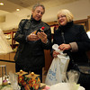 Peter and Vicki Rowcliffe, tourists from the United Kingdom, browse through goods at Bernard's Jewlers on Essex St. in Salem. David Le/Staff Photo