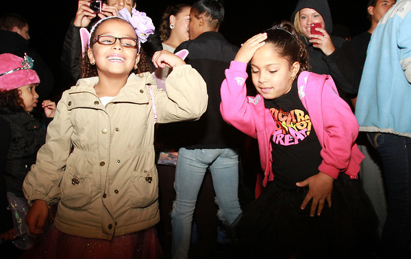 Natalie Dominguez, 6, left, and Jesaniz Rivera, 7, right, both of Salem, dance near the gazebo in Salem Common following the annual Salem Halloween Parade on Thursday evening. David Le/Staff Photo
