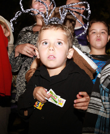 Cormac Warner-Streff, 4, of Salem, watches street performers during the annual Salem Halloween Parade. David Le/Staff Photo