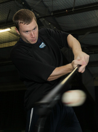 Former St. John's Prep baseball star Matt Antonelli hits a few balls off a tee at Route 1 SportsPlex on Monday afternoon. A free agent this offseason Antonelli is looking to sign with a ballclub this winter. David Le/Staff Photo