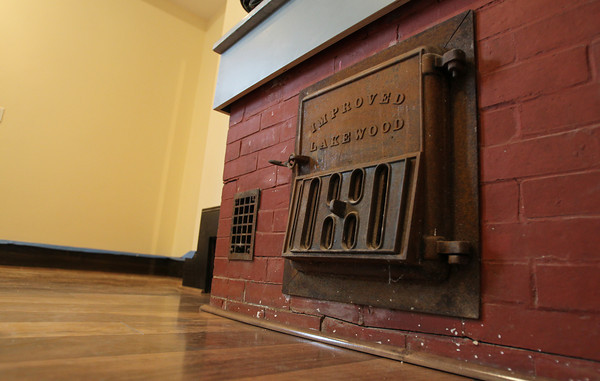 Part of an old stove inside a short term housing unit at the Coach House at Willowdale Estate. David Le/Staff Photo