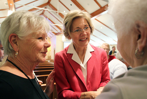 US Senate candidate Elizabeth Warren talks with Protestant Pastor of Brooksby Village Emily Chandler, left, and Brooksby Village resident Beverly Johnson, right, following a speech in the Interfaith Chapel at Brooksby Village on Monday afternoon. David Le/Staff Photo