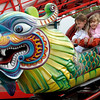Topsfield:<br /> Lexi Stavros, 7, left, of Danvers, and Gina Zollo, 4, of Canton, enjoy one of the amusement rides at the Topsfield Fair.<br /> Photo by Ken Yuszkus/The Salem News, Monday, October 8, 2012.