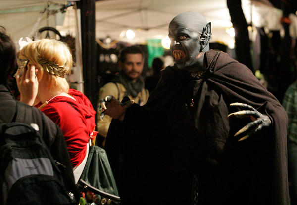 """A man dressed as """"Kurt Barlow,"""" a character from Stephen King's novel """"Salem's Lot,"""" prowls the pedestrian mall during Halloween in Salem.<br /> Photo by Ken Yuszkus."""