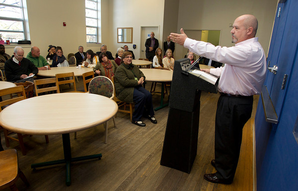 Director of Lifebridge Mark Cote addresses a large crowd gathered inside the newly named Andrew and Carla Oliver Lifebridge Centre on Margin St. in Salem on Tuesday afternoon. David Le/Staff Photo