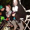 Maria Meimeteas, 11, right, and her sister Angelina, 6, of Salem, sit on a podium next to Salem Common and watch as the annual Halloween Parade passes by. David Le/Staff Photo