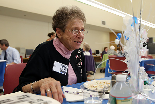 Mary Franggos, a member of the Peabody High School Class of 1942, enjoys talking with former classmates at their 70th Reunion at the Torigian Community Life Center on Friday afternoon. David Le/Staff Photo