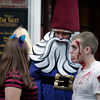 Dressed as the Travelocity gnome, Christopher Lawrence of Middleton walks the pedestrian mall during Halloween in Salem.<br /> Photo by Ken Yuszkus.