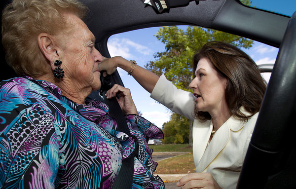 Cathy Andre, right, Volunteer Coordinator at the Danvers Senior Center, shows Danvers resident Gloria Lipinski, left, how to properly put on a seatbelt and adjust it during a 'CarFit' program. David Le/Staff Photo