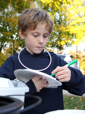 Connor Bell, 7, of Essex, colors a Halloween ornament on Friday afternoon.  David Le/Staff Photo