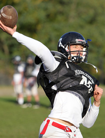 Marblehead senior quarterback Ian Maag lofts a touch pass downfield during practice on Wednesday afternoon. Maag and the undefeated Magicians welcome the Gloucester Fishermen on Friday evening. David Le/Staff Photo