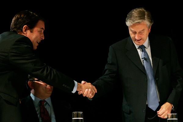 Danvers:<br /> Richard Tisei, left, shakes hands with John Tierney, right, with Daniel Fishman in the middle at the beginning of the debate at Danvers High School.<br /> Photo by Ken Yuszkus/The Salem News, Wednesday, October 10, 2012.