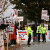 Danvers:<br /> Sign holders outside Danvers High School prior to the debate.<br /> Photo by Ken Yuszkus/The Salem News, Wednesday, October 10, 2012.