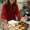 Danvers:<br /> Michelle Carroll fills a tray with cupcakes in the human resources office in Danvers Town Hall during the annual townwide open house. Besides cupcakes she was giving away glowsticks.<br /> Photo by Ken Yuszkus/The Salem News, Thursday, October 11, 2012.