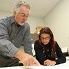 US Biological President Warren Shore, left, goes over floor plans with IT and Marketing Specialist Ana Duarte, right. David Le/Staff Photo