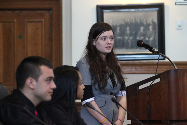 Alan Burke/Staff photo Mock trial judges Scott Myer and Christine Delorbe of Peabody High School listen as student witness Coutney McNeil, playing the part of Union prisoner, tells of the grim conditions at Andersonville Prison during the Civil War.