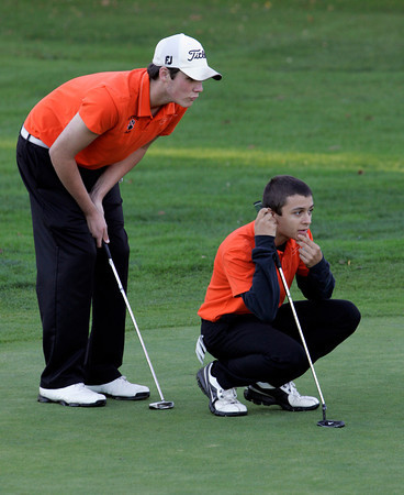 Beverly:<br /> Beverly's Shamus Desmond, left, and Dustin Dube, talk about Shamus' shot on the 6th green during the Gloucester at Beverly golf match held at the Beverly Golf & Tennis Club.<br /> Photo by Ken Yuszkus/The Salem News, Thursday, October 11, 2012.