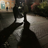 Lights illuminate costumed figures and cast long shadows on the pavement during Halloween in Salem.<br /> Photo by Ken Yuszkus.