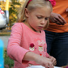 Jenny White, 5, of Ipswich, makes a Halloween decoration on Friday afternoon.  David Le/Staff Photo