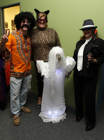 """From left, Mark Pecukonis, of the Beverly Chamber of Commerce, Diane Gavin, Business Liason from R&L Associates, and Fran Dichner, owner of R&L Associates at the Beverly and Peabody Chamber of Commerce's """"Spooktacular."""" David Le/Staff Photo"""