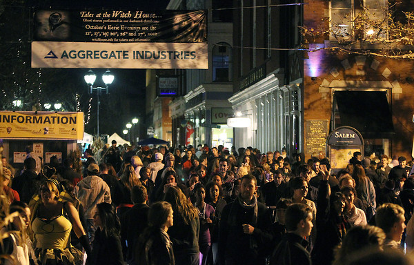 Thousands of people walked around downtown Salem in the Essex St. pedestrian mall on Saturday evening for Halloween festivities.  David Le/Staff Photo