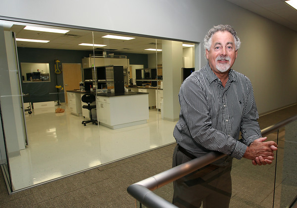US Biological President Warren Shore, stands in front of one of the research labs in his new complex on Technology Way in Salem. David Le/Staff Photo