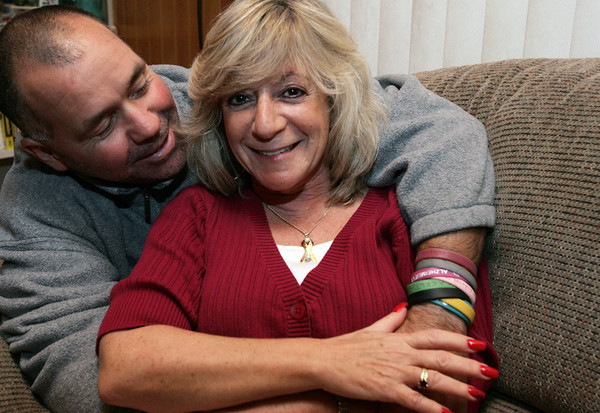 Peabody:<br /> Sherri Temkin is a breast cancer survivor. She is hugged by her boyfriend Bob Oliver.<br /> Photo by Ken Yuszkus/The Salem News, Monday, October 8, 2012.