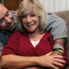 Peabody:<br /> Sherri Temkin is a breast cancer survivor. She is hugged by her boyfriend Bob Oliver.<br /> Photo by Ken Yuszkus/The Salem News, Monday, October 8, 2012.