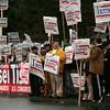 Danvers:<br /> Sign holders outside Danvers High School prior to the debate.<br /> Photo by Ken Yuszkus/The Salem News, Wednesday, October 10, 2012.