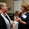 Robin Crosbie, right, newly elected Town Manager of Ipswich, talks with Town Selectman Shirley Berry, left, on Wednesday evening at the Ipswich Museum. David Le/Staff Photo