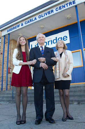 Marblehead resident Andrew Oliver, center, with his wife Carla, right, and daughter Sacha, left, outside the Lifebridge Homeless Shelter on Margin St. in Salem after the shelter was dedicated in honor of Andrew and Carla Oliver's work there. David Le/Staff Photo