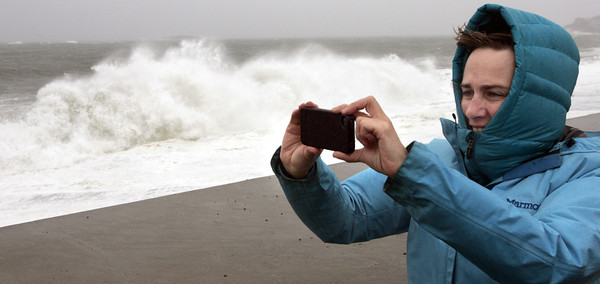 Marblehead:<br /> Robin Berry of Marblehead, takes photos of the waves crashing against the seawall on Ocean Avenue at Devereux Beach during high tide.<br /> Photo by Ken Yuszkus/The Salem News, Monday, October 29, 2012.