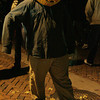Mark Lobsitz of Salem wears a carved pumpkin over his head while strolling down the pedestrian mall during Halloween in Salem.<br /> Photo by Ken Yuszkus.