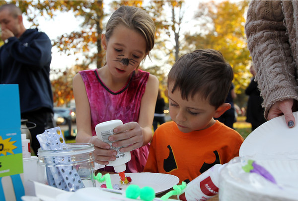 Jacqui Bowser, 10, left, helps her brother Shamus, 4, make a Halloween decoration on Friday afternoon.  David Le/Staff Photo