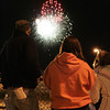 People watch the fireworks at the conclusion of the festivities on Halloween night in Salem.<br /> Photo by Ken Yuszkus