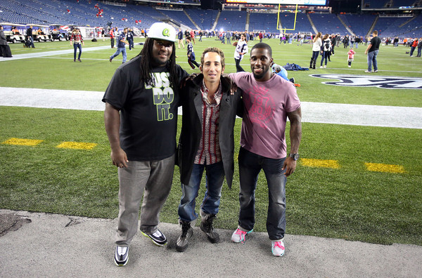 Salem Native and current Danver resident Sean Stellato, center, poses with two of his clients, New England Patriots defensive lineman Kyle Love, left, and cornerback Kyle Arrington, right, following a 31-21 Patriots victory over the Denver Broncos. David Le/Staff Photo