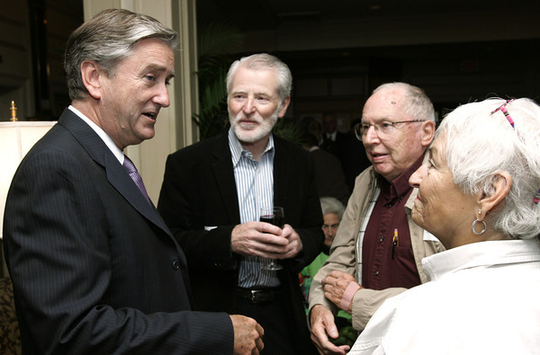 Salem:<br /> From left, Congressman John Tierney greets his guests, Sean Gresh of Ipswich, Joe Perkins of Beverly, and Lois Nicholson of Salem, as he arrives at his fundraiser event held at the Hawthorne Hotel.<br /> Photo by Ken Yuszkus/The Salem News, Monday, October 8, 2012.