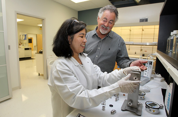 US Biological President Warren Shore, right, talks with Research Director Mel Tipa. David Le/Staff Photo