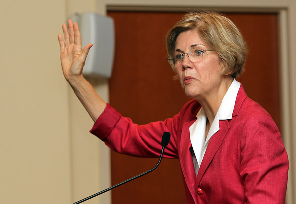 US Senate candidate Elizabeth Warren campaigns at Brooksby Village on Monday afternoon, talking with residents and answering a few questions they had. David Le/Staff Photo