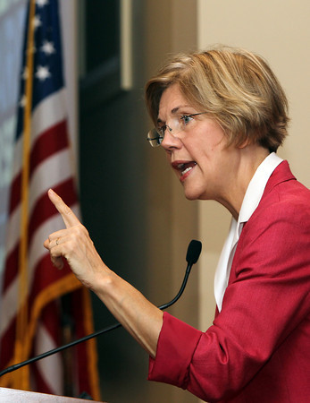 US Senate candidate Elizabeth Warren speaks empathically to Brooksby Village residents on Monday afternoon while on the campaign trail. David Le/Staff Photo