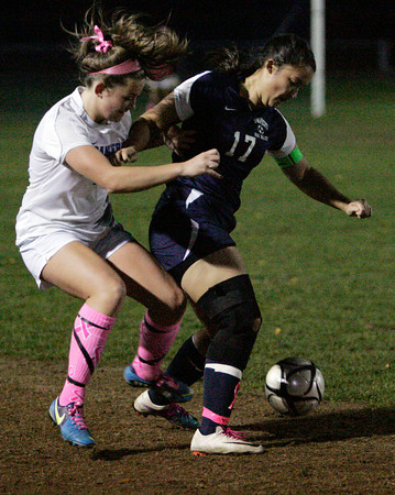 Danvers:<br /> Danvers' Shannon Pohle, left, and Swampscott's 17 fight over the ball during the Swampscott at Danvers girls soccer game.<br /> Photo by Ken Yuszkus/The Salem News, Monday, October 22, 2012.
