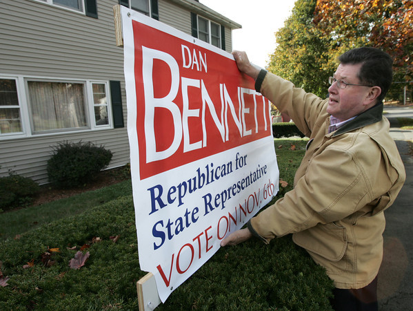 Danvers:<br /> Dan Bennett, places a sign on Vineyard Street before dropping literature in Danvers as he runs for state Rep. of the 13th Essex District.<br /> Photo by Ken Yuszkus/The Salem News, Tuesday, October 23, 2012.