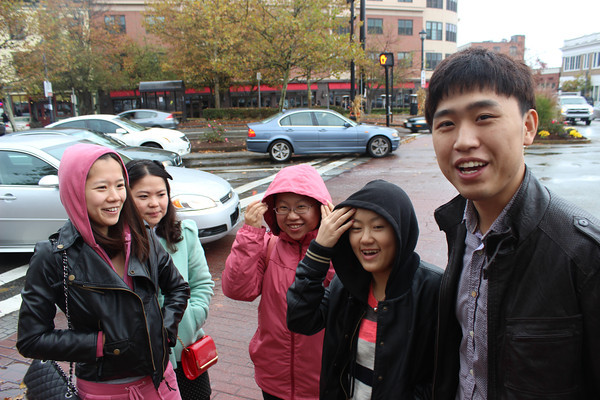 A group of Chinese students visiting Salem for Halloween were stunned to hear that the city hosts real witches. From left are Xiayan Liu, Chao Zhang, Wan Chi Chung, Zhoa Kiying and Hao Tian.<br /> Alan Burke/Staff photo