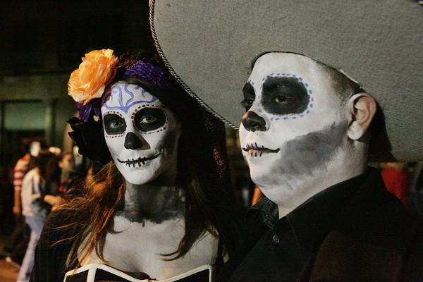 Michaela Pelletier of Webster and Carlos Garduno of Lynn in costume for Halloween night in Salem.<br /> Photo by Ken Yuszkus.